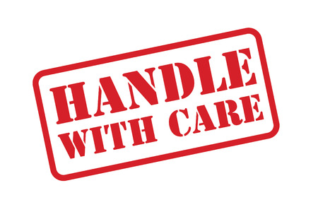 handling: HANDLE WITH CARE rubber stamp over a white background.