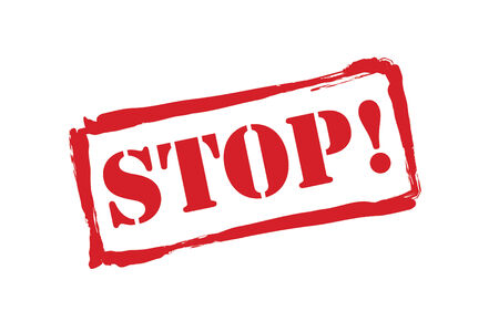 halted: STOP! red rubber stamp over a white background.