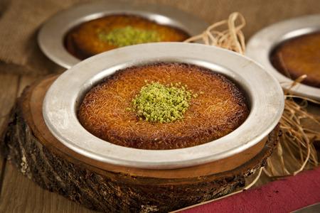 Turkish dessert kunefe with pistachio powder