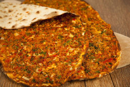 tomatto: Turkish specialty pizza lahmacun pide with parsley and lemon