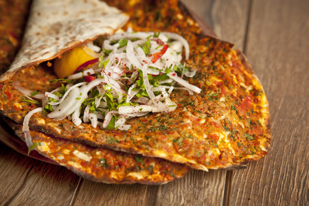 Turkish specialty pizza lahmacun pide with parsley and lemon photo