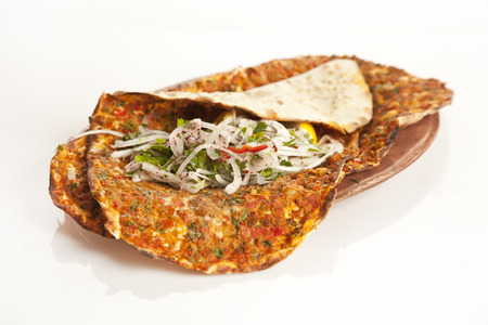 Turkish specialty pizza lahmacun pide with parsley and lemon isolated white backgorund Archivio Fotografico