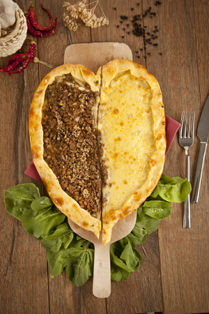 Delicious heart shaped meat and cheese Turkish pizza pide photo