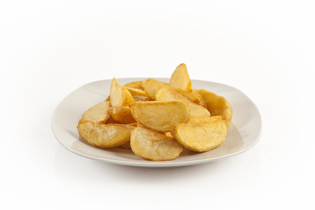 Fried potato wedges isolated with clipping path photo
