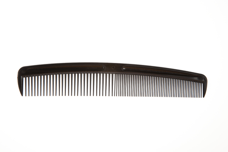 long handled: Black comb isolated on white background