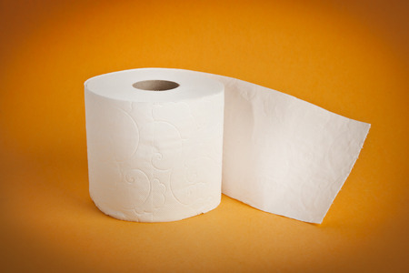 Simple toilet paper on yellow background photo