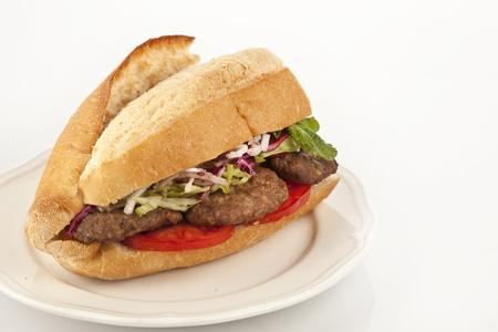 Delicious Turkish Kofte Sandwich (meatballs) isolated white background photo