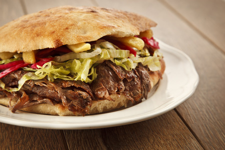 Doner Kebab - grilled meat, bread and vegetables shawarma sandwich photo