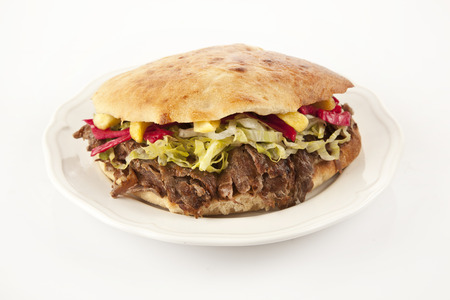 Doner Kebab - grilled meat, bread and vegetables shawarma sandwich