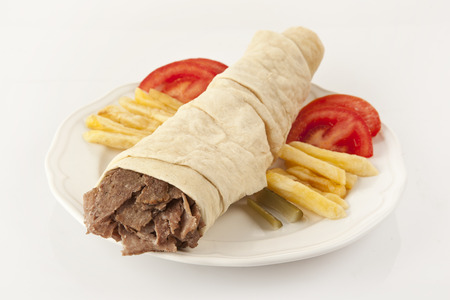 Tortilla with a delicious turkish doner grilled meat photo