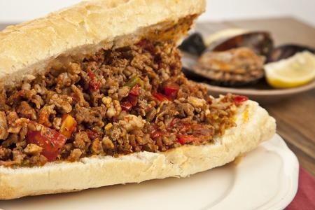 bowels: Turkish Kokorec - lamb intestine food sandwich with midye dolma Stock Photo