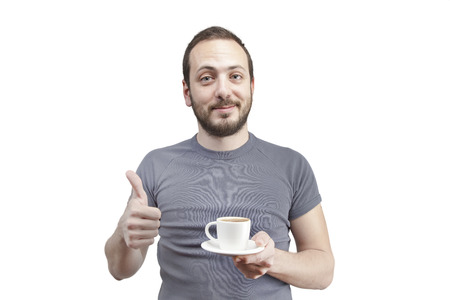 young man drinking a cup of coffee or tea isolated white background photo