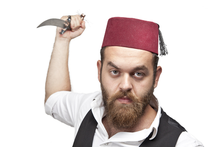 Man in traditional turkish hat and dress kabadayi with knife photo