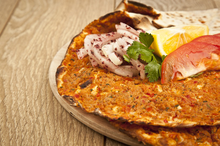 Turkish specialty pizza lahmacun pide with parsley and lemon