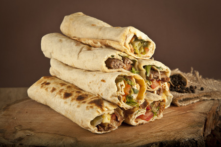 Turkish Shawarma durum Traditional sish kebab wrap Stock Photo