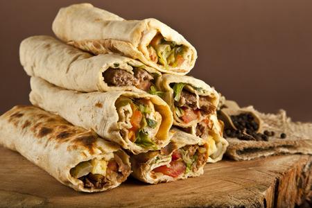 doner: Turkish Shawarma durum Traditional sish kebab wrap Stock Photo