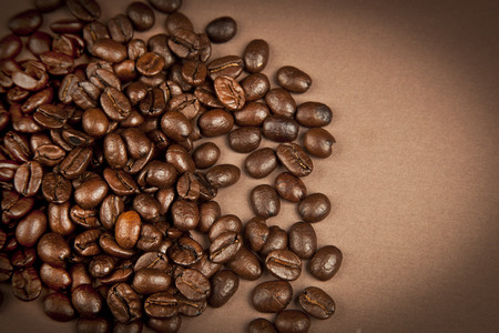 woodenrn: Coffee beans with brown background