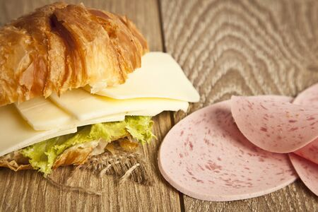 Close up of ham and cheese croissant sandwich. photo