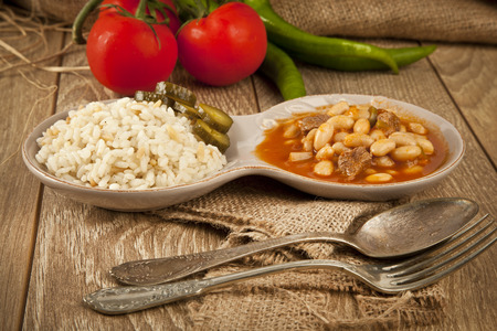Hot turkish bean stew with a tasty tomato sauce and rice turkish pilav photo