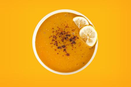 Lentil cream soup with lemon slices