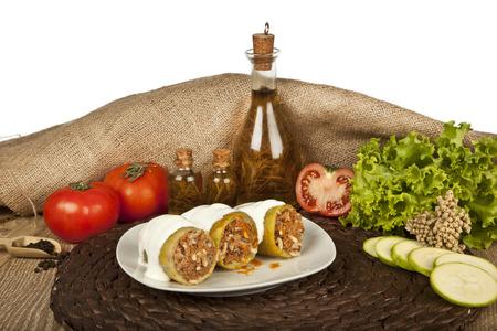 greek cuisine: Stuffed zucchini, kabak dolmasi, Turkish and greek cuisine with concept background