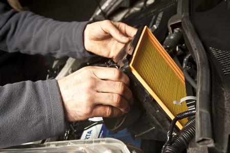 Auto mechanic working in garage. Repair service.
