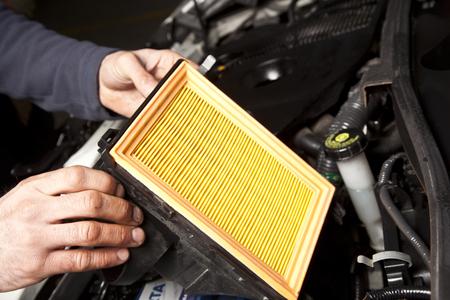 auto repair: Auto mechanic working in garage. Repair service.