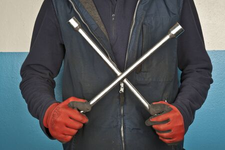 Wheel wrench in hand with gloves