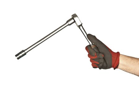 locking up: Wheel wrench in hand with gloves