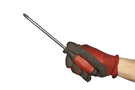 Hand holding a red and black screwdriver isolated over white background