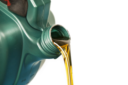 gold cans: Motor oil, car engine close up