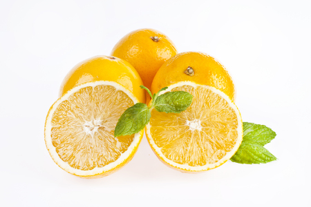 Oranges with slice on white background Imagens