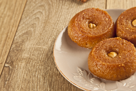 appetising: Turkish Ramadan sweet - Sekerpare with wooden background