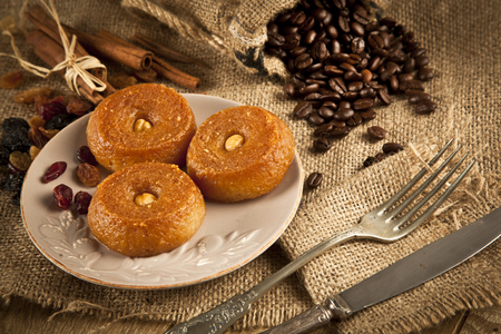 woodenrn: Turkish Ramadan sweet - Sekerpare with wooden background