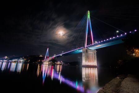 full red: Full red Moon with shining bridge photo taken at tholsan Yesou Beach. South Korea. Archivio Fotografico