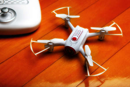 small quadrocopter drone mini white text keywords notebooks rc backgrounds desktop wallpaper cmd commando space clip paste view top trend hd 4k video footage montage Stock Photo