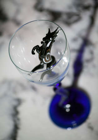 Black horse empty glass marble table