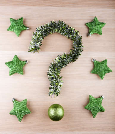 Tinsel question mark new year toy ball green stars Stock Photo