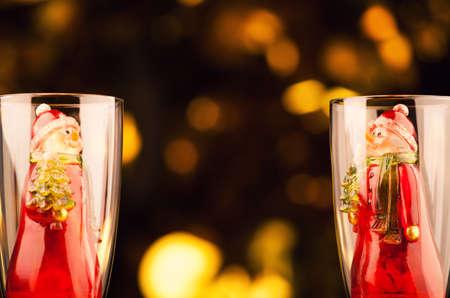 glass champagne snowman gold bokeh