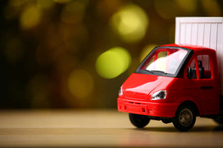 toy car wooden table gold bokeh Stock Photo