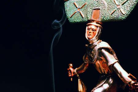 shaman figure smoke dark background