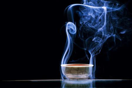 Chinese black tea cup smoke dark background nobody