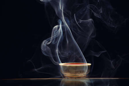 Chinese black tea cup smoke dark background nobody