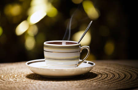 hot tea cup gold bokeh Stock Photo