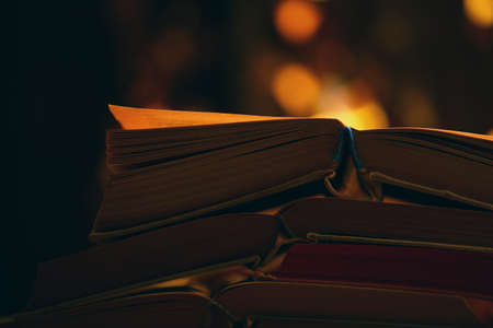 old books gold bokeh Stock Photo