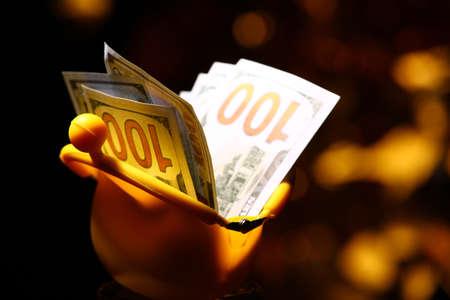 yellow purse money dollar gold bokeh