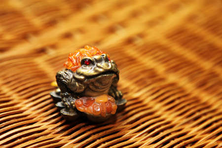 money bronze toad wooden background