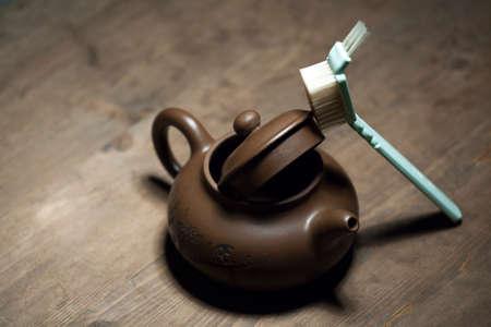 empty teapot brush wooden sharp table nobody