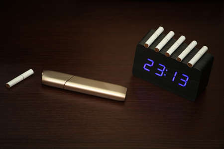 electronic smoke device wooden clock table nobody