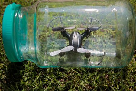 quadcopter glass jar grass background nobody